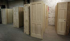 A photo of door slabs and pine door blanks