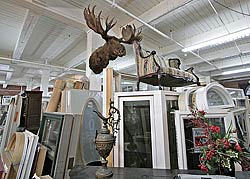 A view of the main floor with a moose head high on a column.