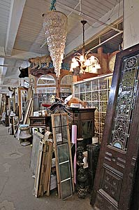 A chandelier hangs above an assortment of antiques and other collectibles