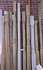Photo of several porch posts.